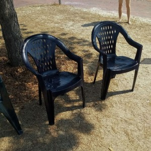 Plastic Chairs and naked legs